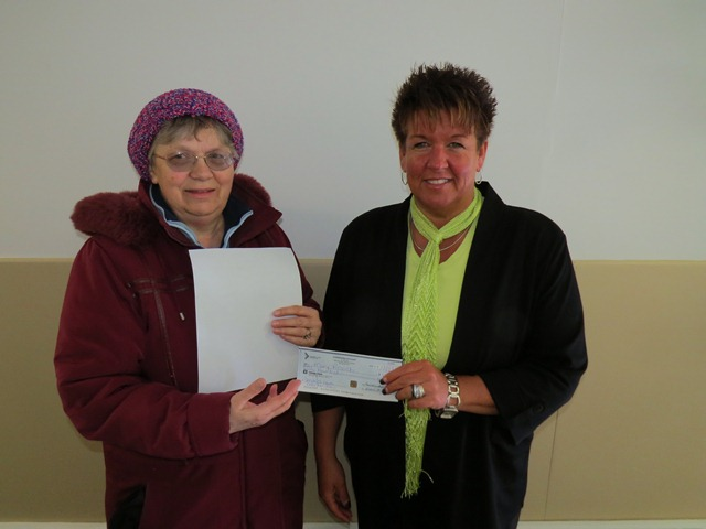 Kim Harvey, Residential Supervisor at Community Living Kirkland Lake presents Helen Rozich with a cheque for $500.  Mrs. Rozich was the big winner in the draw that awarded $2000 in prizes to 22 lucky winners in January.